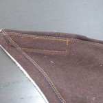 ***Close up of the front left corner, the long strip is completely sewn on and the stitching is visible.