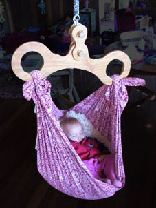Medium image of the hangup is an australian hammock  there is the ability to add a cushion of different sizes depending on the age of the baby or use no cushion