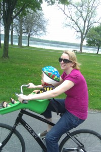 Side view of the pregnant tummy on a bike.  Oh so flattering!