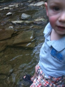 Cooling his feet off in the creek