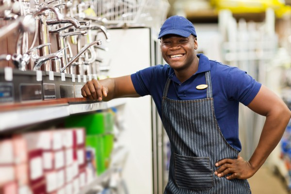 cheerful african hardware store worker