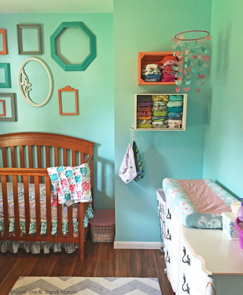 Beautiful nursery with cloth diapers on the wall