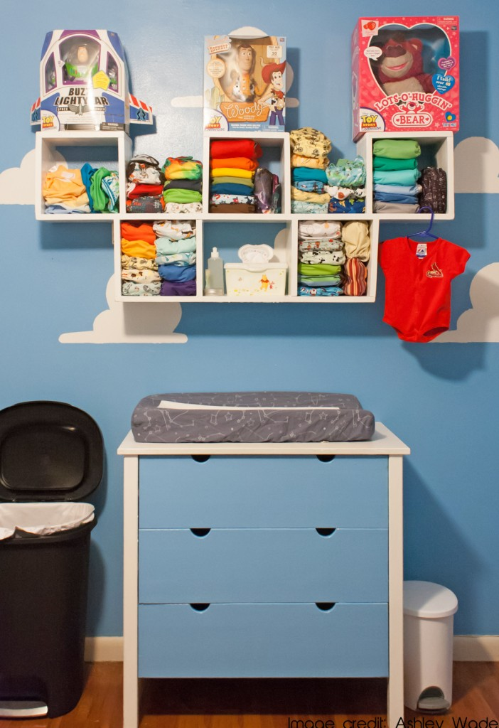 Toy Story inspired nursery with custom shelving for cloth diapers