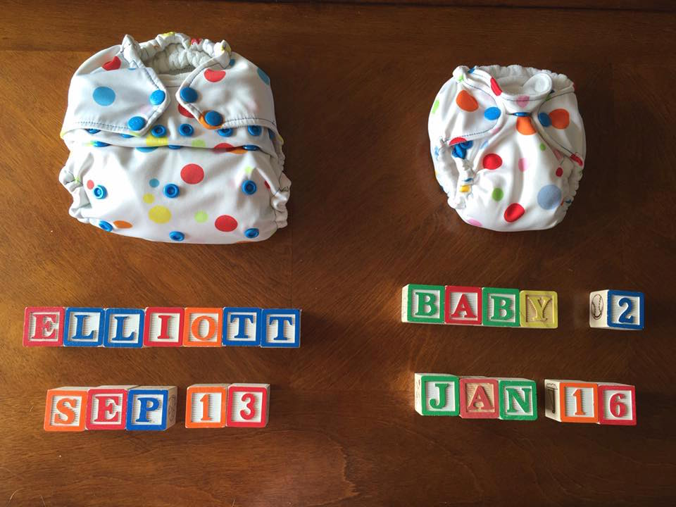 Alphabet blocks and diapers pregnancy announcement