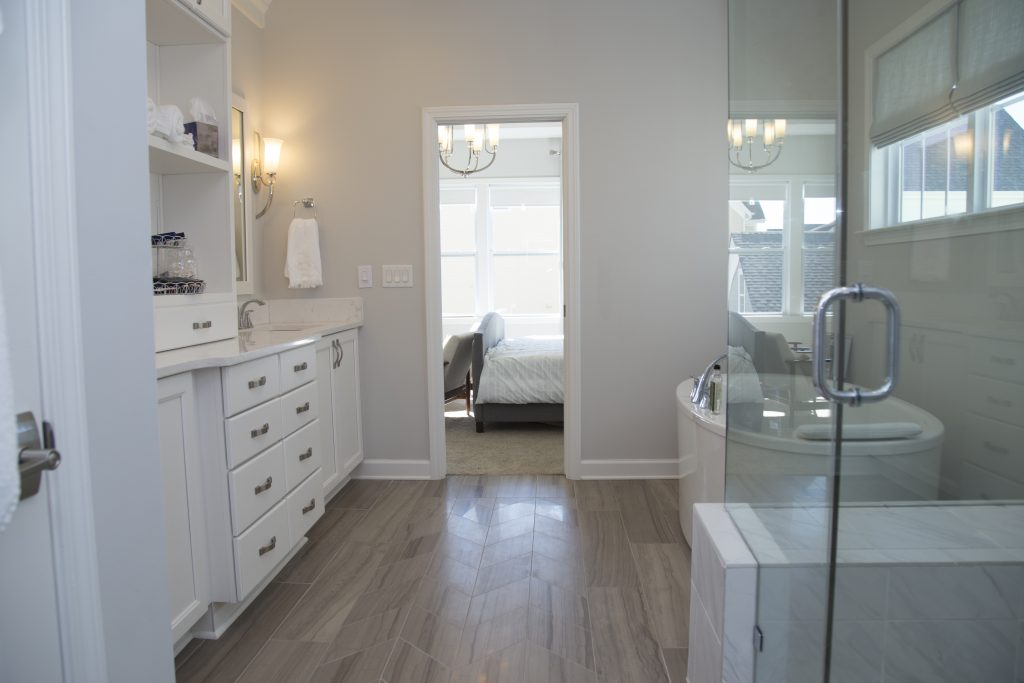 Master bathroom connected with a pocket door to bedroom