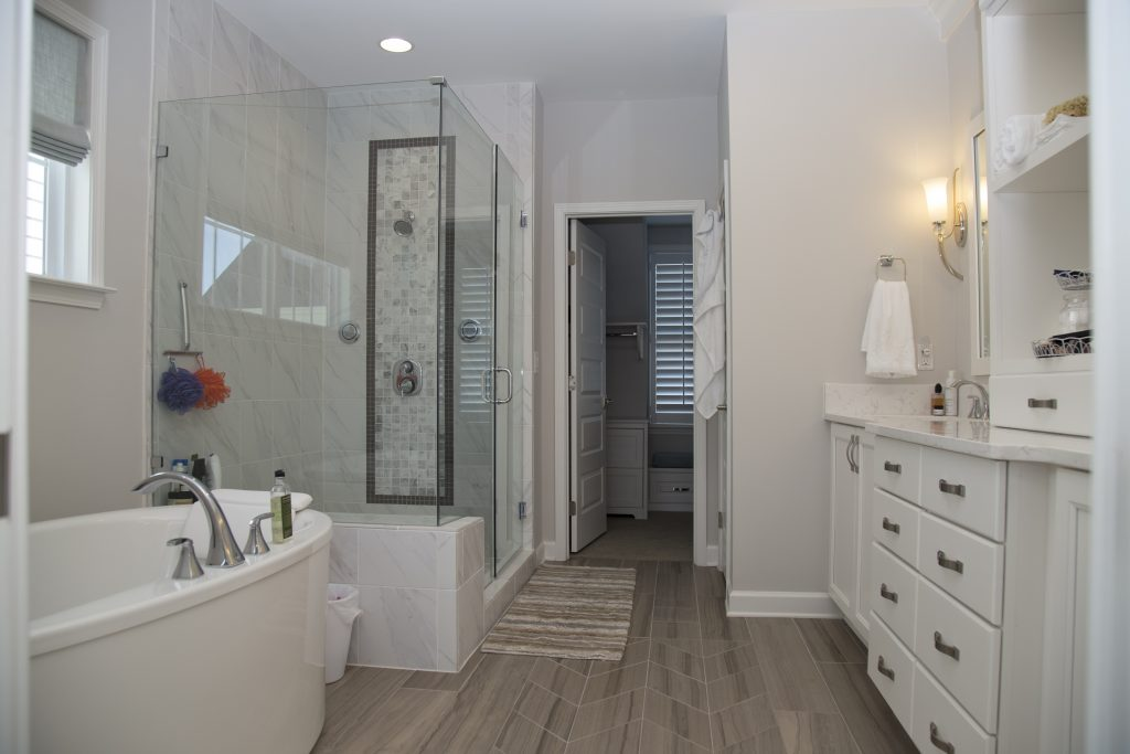 Master bathroom connects bedroom to master closet