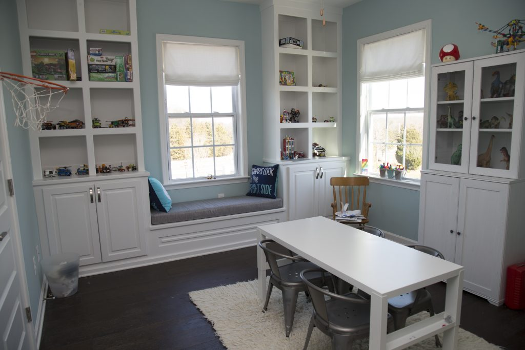 Activity room with built-in shelves and cabinets